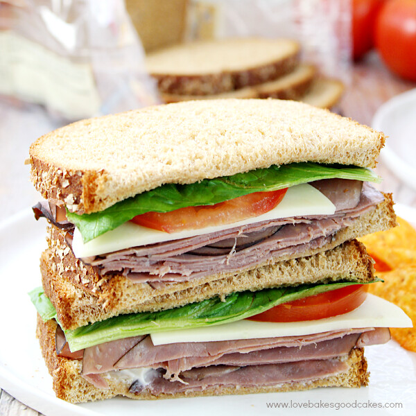 Roast Beef Sandwiches with Horseradish Mayonnaise stacked on a plate close up.