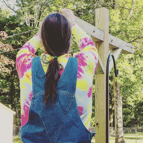 Stringing the new clothesline #HomeImprovement #overalls #tiedye