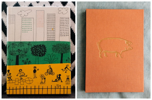 olle eksell book and pink notebook with gold pig