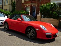 porsche 911 gt2(0.0), porsche carrera gt(0.0), automobile(1.0), automotive exterior(1.0), wheel(1.0), vehicle(1.0), performance car(1.0), automotive design(1.0), porsche 911(1.0), porsche(1.0), rim(1.0), bumper(1.0), land vehicle(1.0), luxury vehicle(1.0), coupã©(1.0), convertible(1.0), supercar(1.0), sports car(1.0),