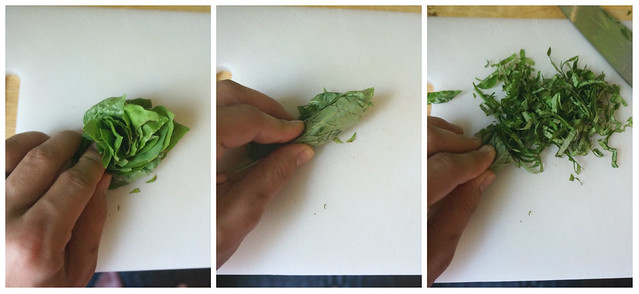 Making a chiffonade, in three steps: stack the leaves, roll tightly, cross-slice the rool into thin ribbons