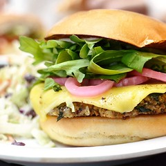 The Grilled Quiona Veggie Burger at @veggiegrill tastes like it was designed just for me. Herby pesto, spicy arugula and tart pickled onions... All my favorite flavors between a bun! #veggiegrill #vegan #vegansofig #VeganCheese #veganshares #veganfoodporn