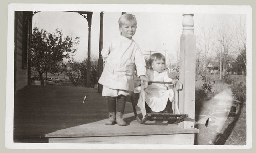 Two children on the porch