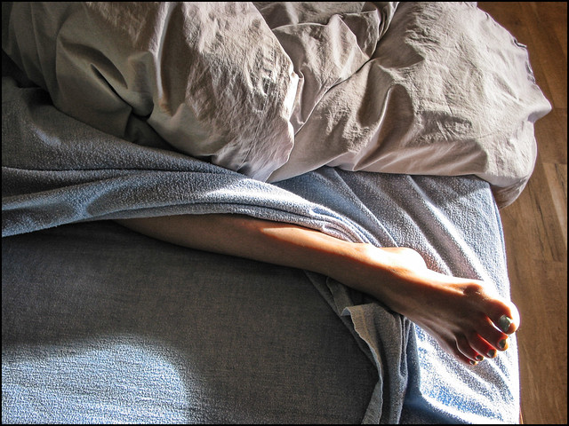 Leg, foot, flannel sheets, strong sunlight....what could be better...hmmmm