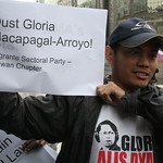 Gil Lebria holding the oust-GMA slogan