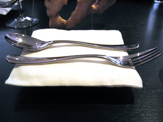 Silverware on linen pillow.