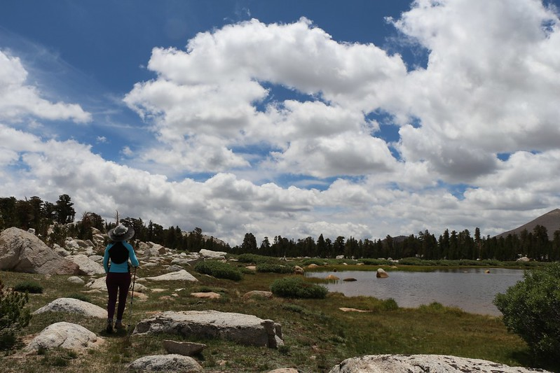 Heading back toward the Cottonwood Lakes Trail as the cumulus clouds grow in size and number