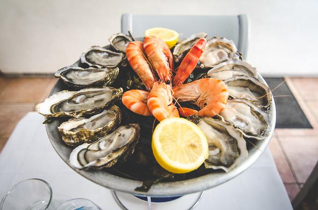 An epic platter of fresh oysters and shrimp at Huîtrerie Régis in Paris.