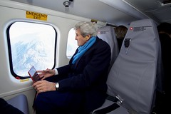 U.S. Secretary of State John Kerry looks out the window of a Swiss Air Force Super Puma helicopter on January 18, 2017, during a flight from Davos, Switzerland, to Basel, Switzerland, after attending the World Economic Forum in Davos on the last stop of the last trip of his tenure as a Cabinet officer. [State Department photo/ Public Domain]