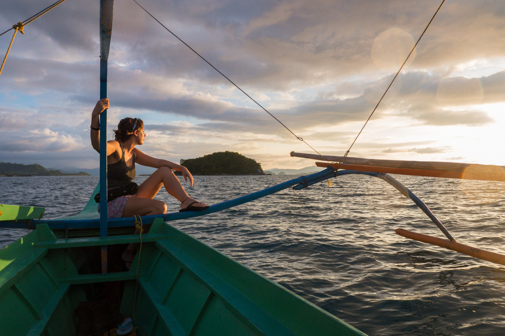 Enjoying the sunset from a local fishermans boat from San Vicente to Port Barton in Palawan, Philippines