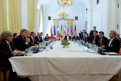 U.S. Secretary of State John Kerry sits next to U.S. Energy Secretary Dr. Ernest Moniz, as well as British Foreign Secretary Philip Hammond, Russian Foreign Minister Sergey Lavrov, German Foreign Minister Frank-Walter Steinmeier, French Foreign Minister Laurent Fabius, and Chinese Foreign Minister Wang Yi, on July 6, 2015, in Vienna, Austria, before the P5+1 member countries met with Iranian officials amid negotiations about the future of their country's nuclear program. [State Department Photo/ Public Domain]