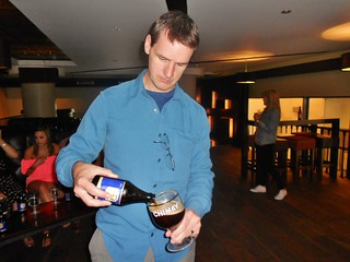 Dennis Pouring Beer
