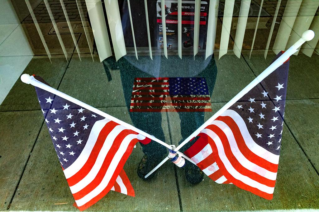 Three flags in North Scranton window in 6-15--Scranton