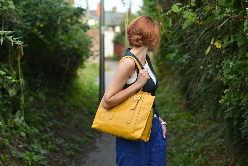 Not Dressed As Lamb: Vest/waistcoat with loose blue trousers, yellow tote
