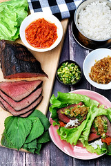 Steak ssam - grilled beef fillet with kimchi, ging…