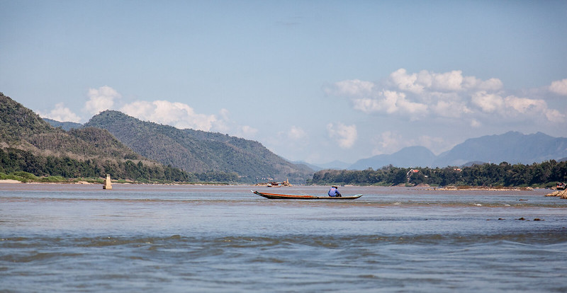 A fisherman at Mekong river in Luang Prabang, Laos