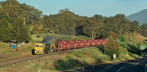 Heading towards the early morning sun, GL112 brings it's track maintenance train through Blandford, NSW (1)