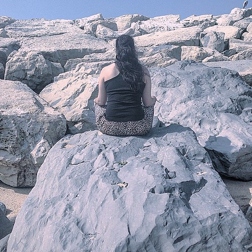 Sitting on rocks.
