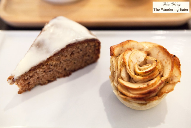Dessert of house made banana cake with nutmeg glaze and spiced apple blossom tart