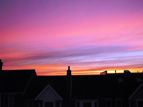 Sunset over Winton rooftops.