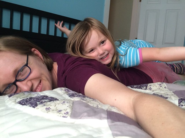 "She likes to lay on my back on the bed. She calls it ""playing alligator"" for some reason :)"