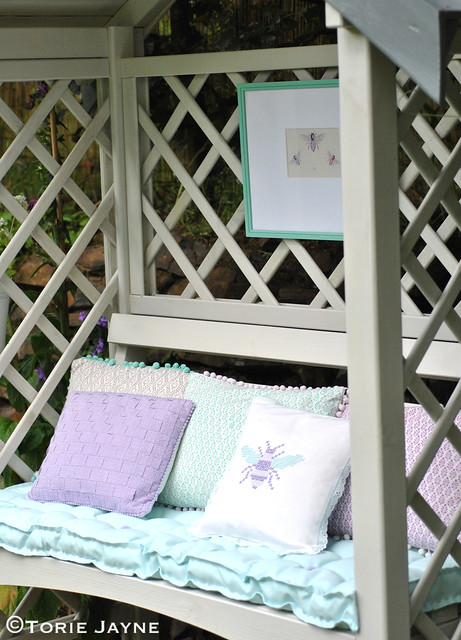 Garden arbour with cushions and frame