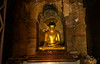 Golden Buddha insaide a temple by Rickloh