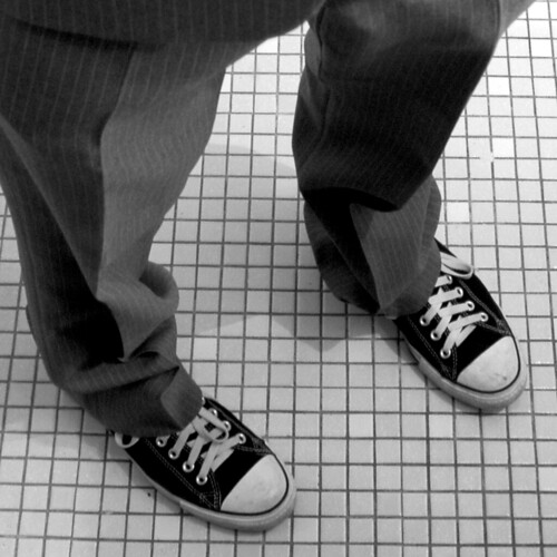 Chuck Taylors and a pinstripe suit by Punkartist