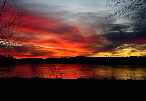 sunset over frozen Lake Nagog