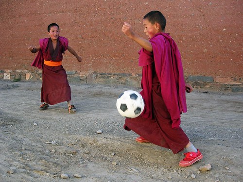 Tibetan child monks practice football