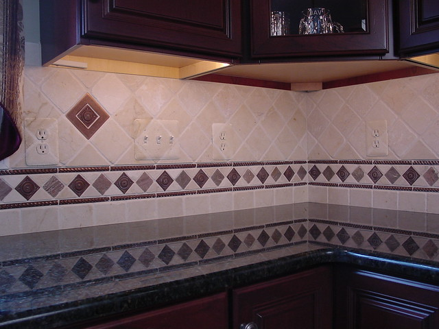 custom backsplash with faux stone plate covers flickr photo