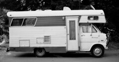 travel trailer(0.0), automobile(1.0), van(1.0), vehicle(1.0), land vehicle(1.0), recreational vehicle(1.0), black-and-white(1.0),