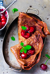 chocolate pancakes with cherry sauce