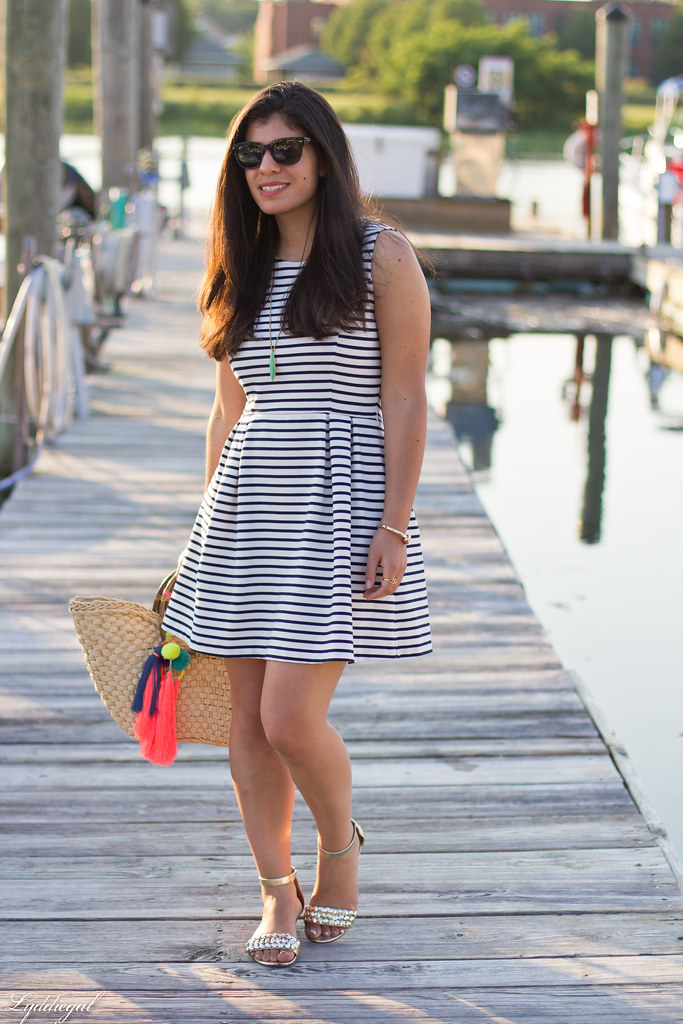 striped dress, straw tote with pom poms, gold sandals.jpg