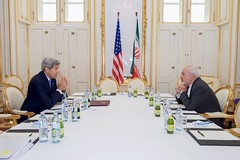 U.S. Secretary of State John Kerry sits across from Iranian Foreign Minister Javad Zarif on June 30, 2015, in Vienna, Austria, before a one-on-one meeting amid negotiations about the future of Iran's nuclear program. [State Department photo/ Public Domain]