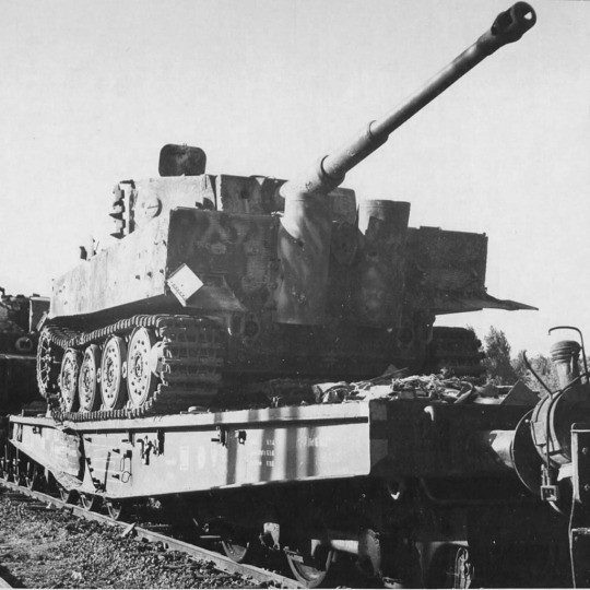 This Tiger is carried by railway to the front.