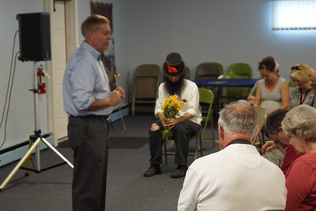 Lindsay Graham offers a Christian prayer in exchange for a flower from Rod Webber
