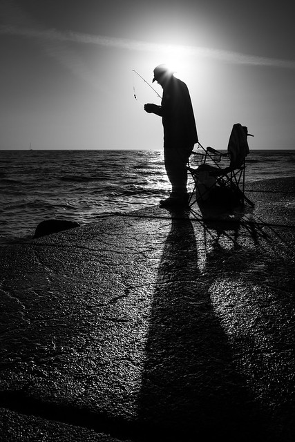 The fisherman - Treasure Island, Florida - Black and white street photography