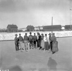 North-West Mounted Police playing hockey in costumes