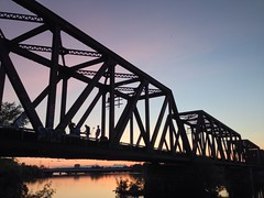 Walkabout: Music video being recorded on old train bridge at sunset.