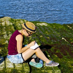 Girl taking notes at the river border