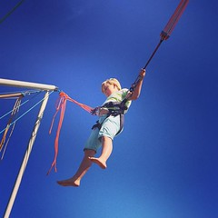 bungee jumping(0.0), sports(0.0), aerialist(0.0), rings(0.0), physical exercise(0.0), adventure(1.0), bungee cord(1.0), extreme sport(1.0), blue(1.0), person(1.0),