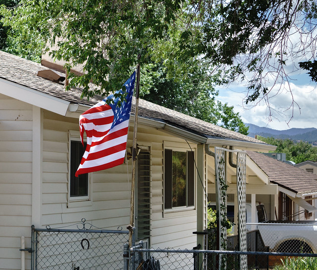 Flag Flying In Front of House