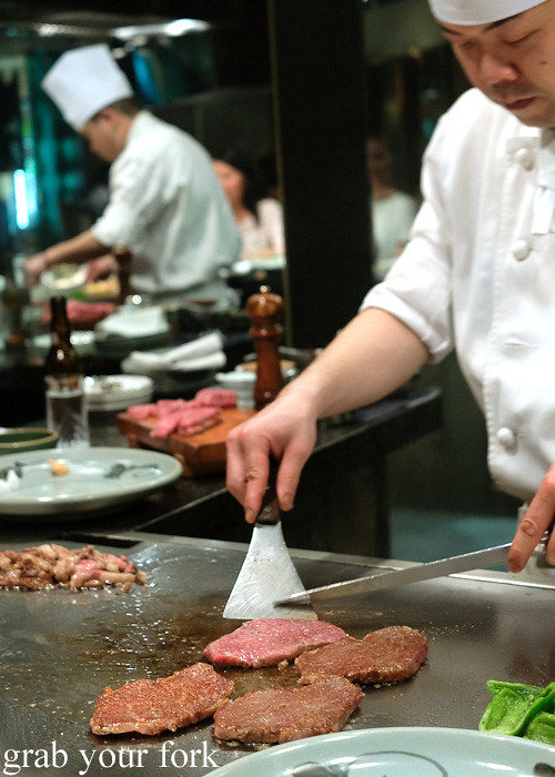 Flipping the Kobe wagyu beef sirloin at Wakkoqu, Kobe, Japan