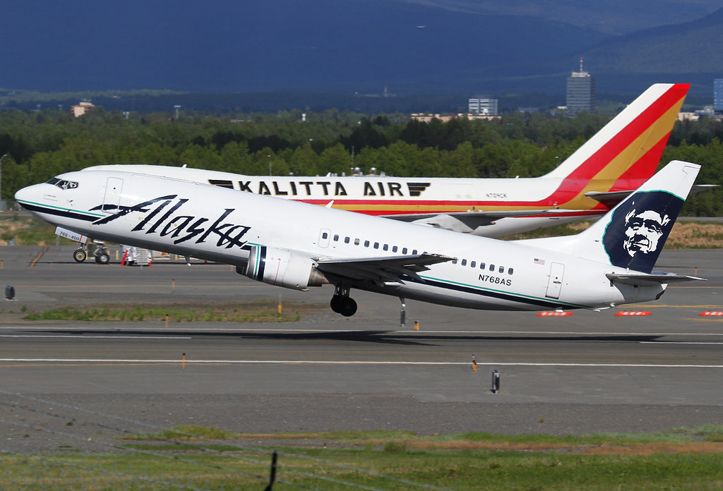 Rather rare combi 737 departs from RWY33 in nice evening light. Kalitta's N704CK adds a touch of color. Delivered 09/1992