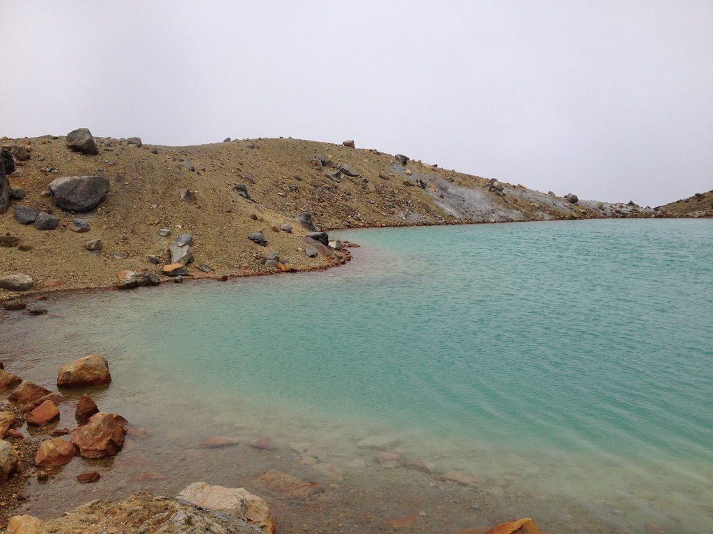 Shore of emerald lake