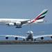 TwoA380s EmiratesAndAirFrance 7715 by Bill Larkins