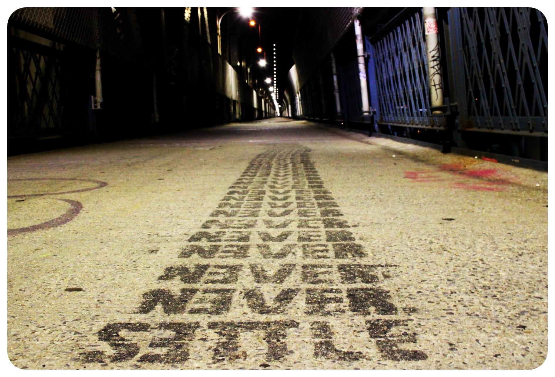 manhattan bridge never settle graffiti new york