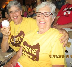 Sr. Mary Frances, holding the first pitch ball,  enjoyed the evening with her sister Susan....