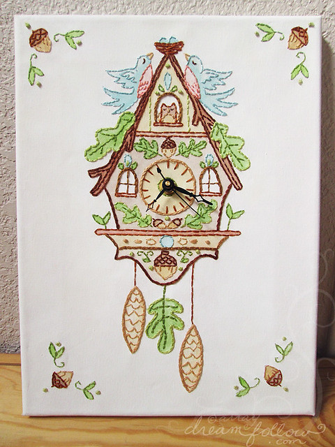 Embroidered cuckoo clock on canvas